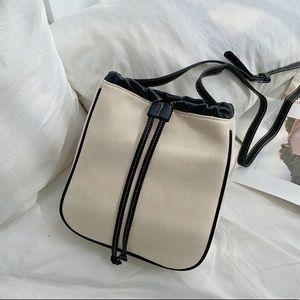 Women's tan leather crossbody bag blue edge